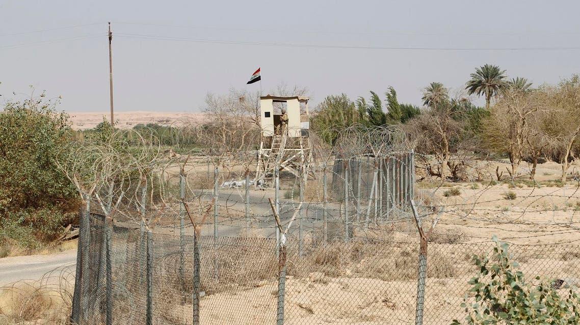 An Iraqi border policeman stands guard on a watch tower on the Iraqi-Syrian border at the Abu Kamal-qaim border crossing. (Reuters)