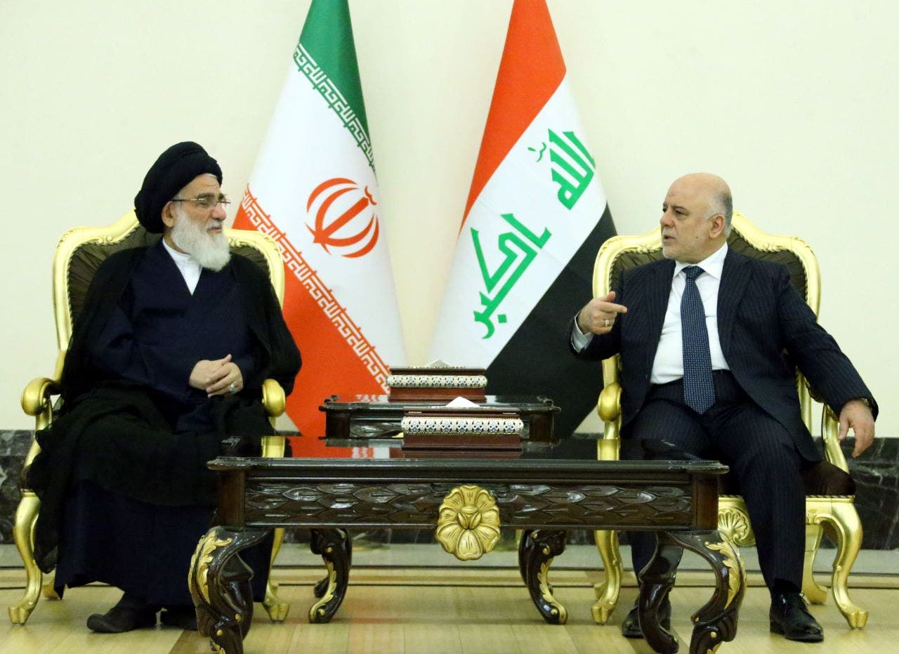 حیدر العبادی نخست وزیر عراق و محمود هاشمی شاهرودی رئیس مجمع تشخیص مصلحت نظام ایران