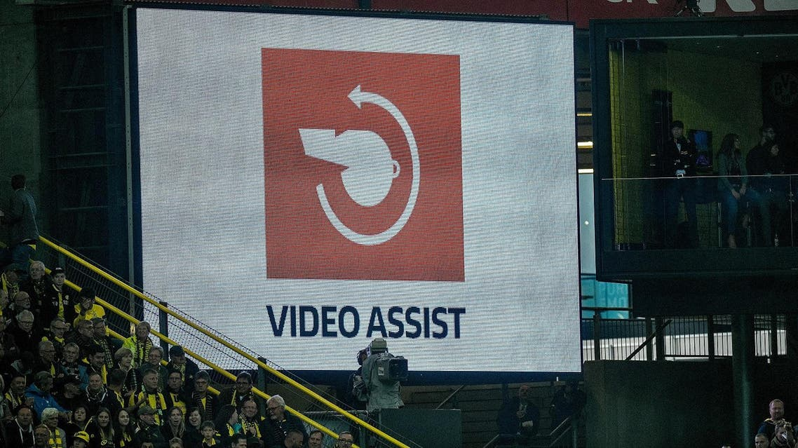 (FILES) This file photo taken on September 17, 2017 shows the logo of the video assistant referee (VAR) on a screen during the German first division Bundesliga football match Borussia Dortmund v FC Cologne in Dortmund, western Germany, on September 17, 2017. Bundesliga fans are demanding the end of video assistant referee (VAR) testing in Germany as the system's German league boss was accused of influencing matches at the weekend of November 5, 2017. (AFP)