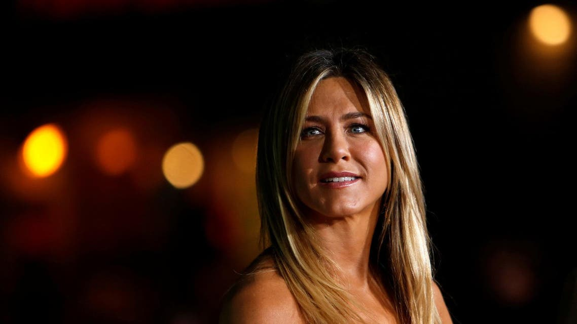 """Jennifer Aniston poses at the premiere of """"Office Christmas Party"""" in Los Angeles on December 7, 2016. (Reuters)"""
