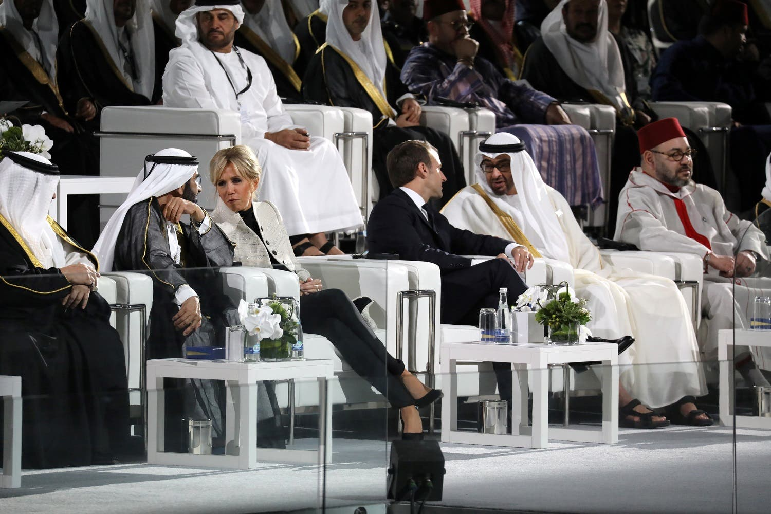 President Macron (C-R) and his wife Brigitte Macron (C-L) chat with Abu Dhabi Crown Prince Mohammed bin Zayed Al-Nahyan (R) and Ruler of Dubai Sheikh Mohammed bin Rashid al-Maktoum during the inauguration of the Louvre Abu Dhabi Museum on November 8, 2017 on Saadiyat island in the Emirati capital. (AFP)