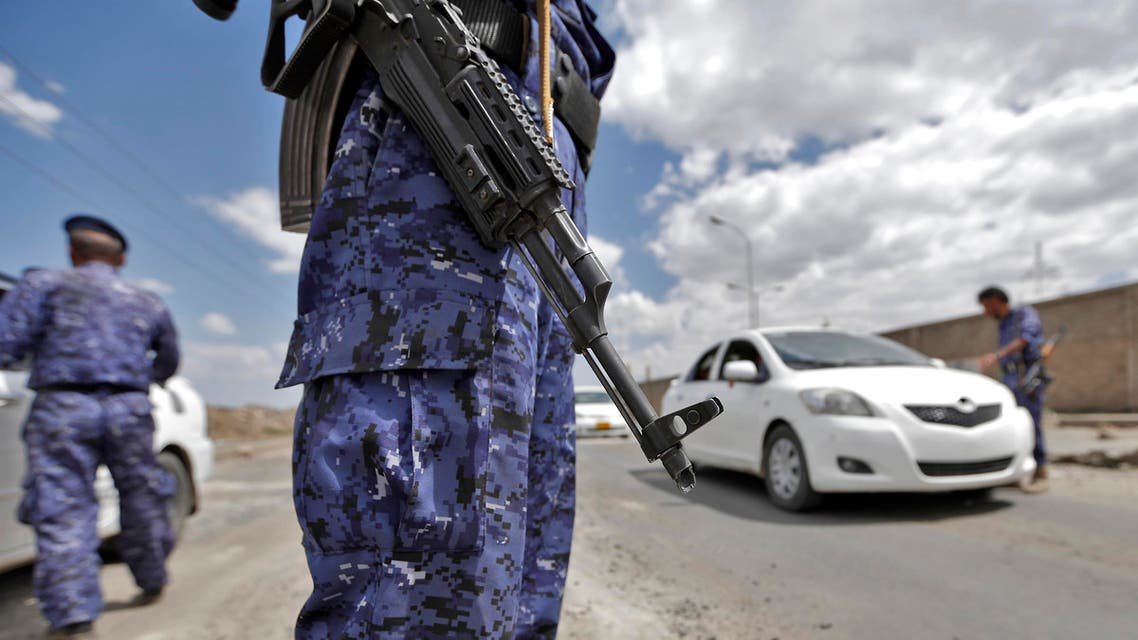 A Yemeni soldier, loyal to the Iran-backed Shiite Huthi rebels, slings a Kalashnikov assault rifle while manning a checkpoint, as the rebels tighten security measures in Sanaa on September 19, 2017 ahead of a demonstration commemorating the third anniversary of their capture of the capital.  MOHAMMED HUWAIS / AFP