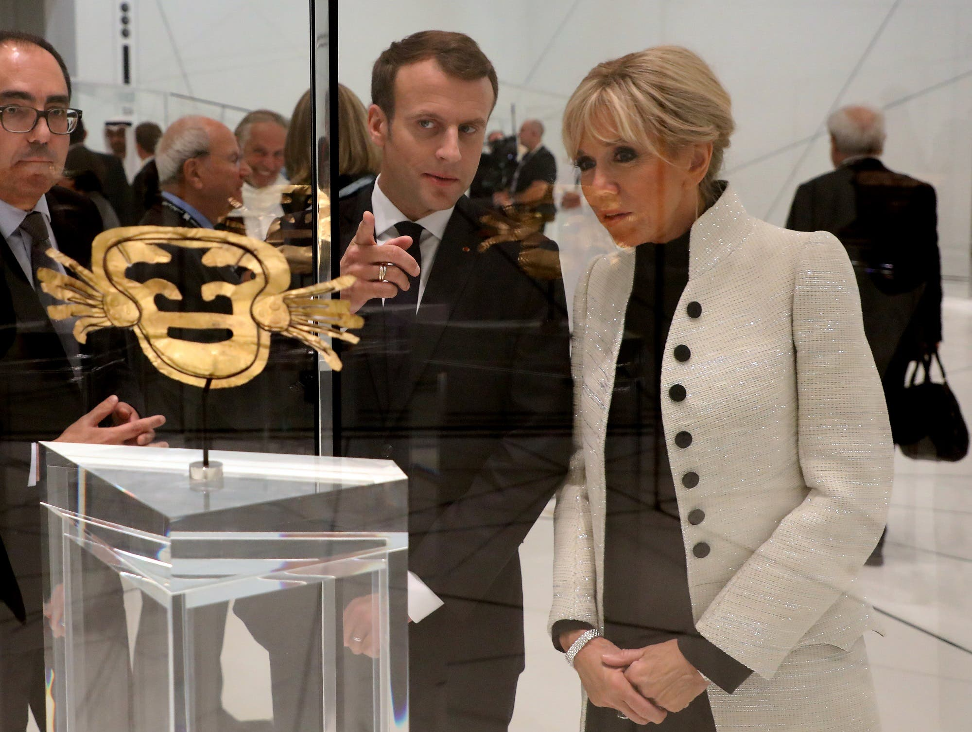 Macron and his wife Brigitte Macron look at a piece of art as they visit the Louvre Abu Dhabi Museum in Abu Dhabi, UAE, November 8, 2017. (Reuters)