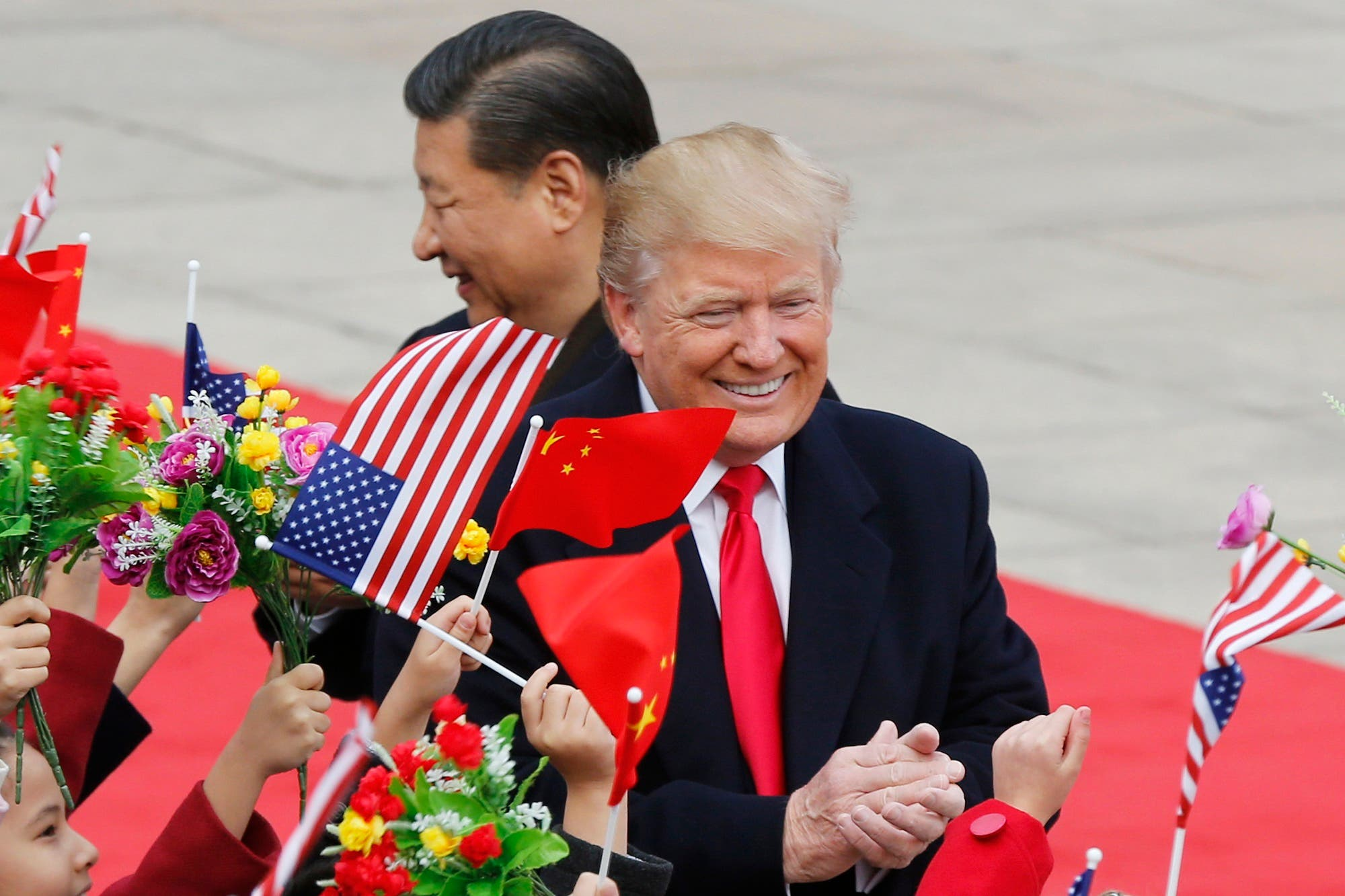 Trump and Xi Jinping greeted by children during a welcome ceremony in Beijing on Nov. 9, 2017. (AP)