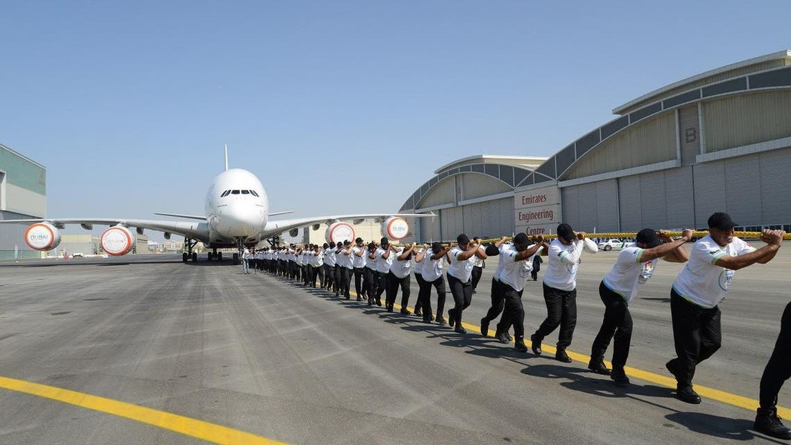 UAE policemen break world record of heaviest aircraft pulled by a team