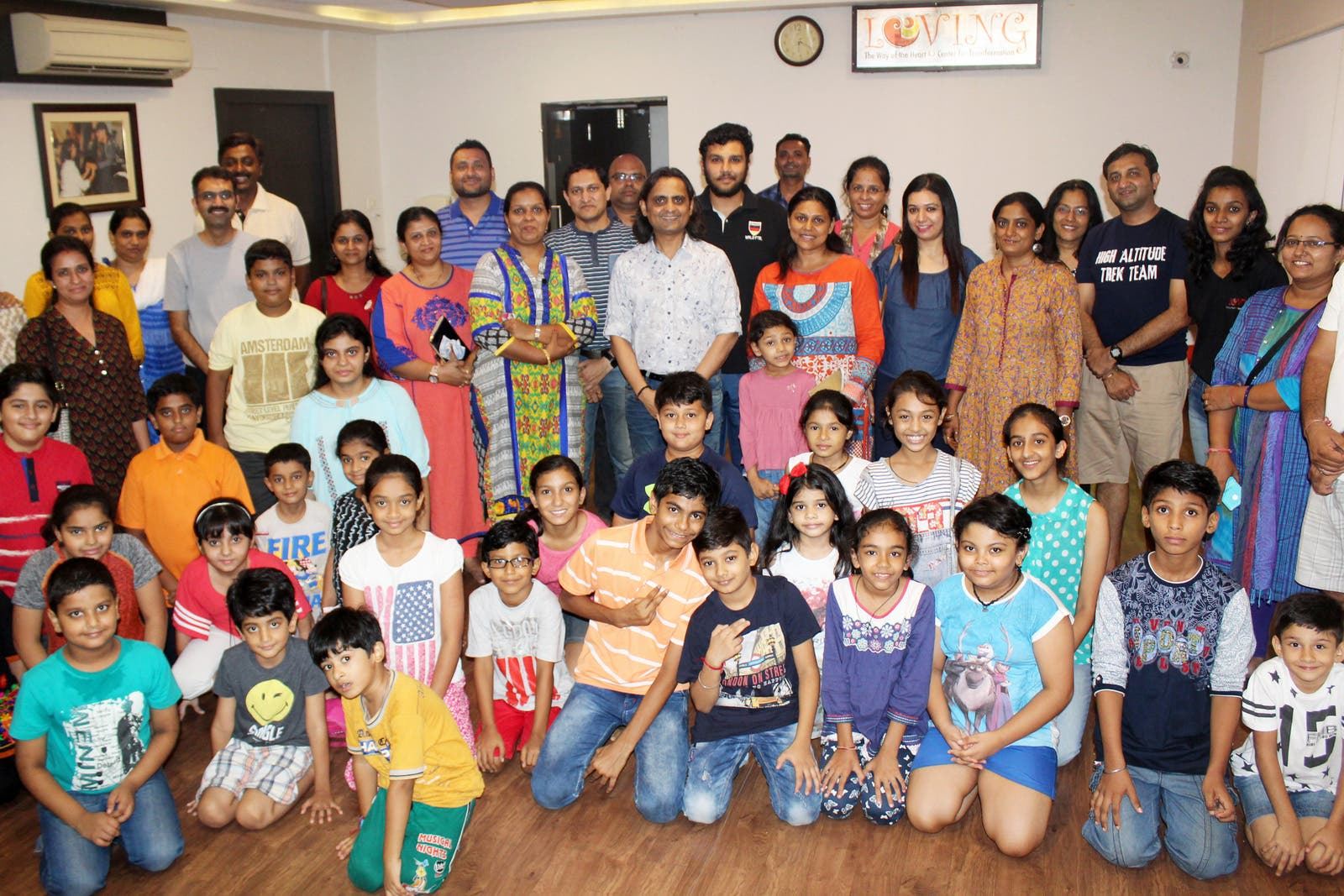 A group of happy parents with their children after the completion of the course at Loving Centre for Transformation. (Supplied)