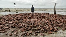PHOTOS: Shrinking island in India triggers climate refugee crisis