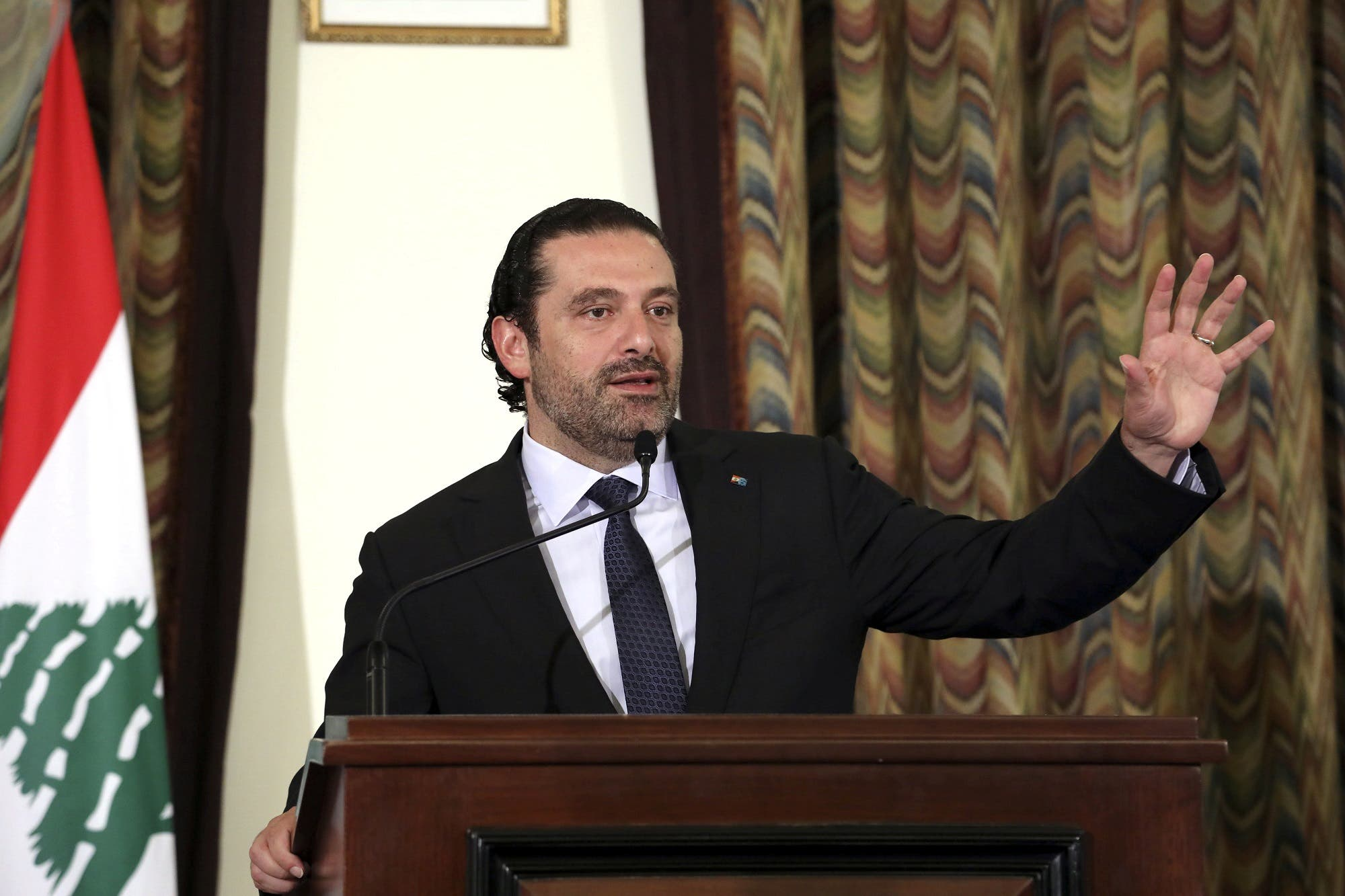 Saad Hariri gestures as he talks at the governmental palace in Beirut on August 10, 2017. (Reuters)