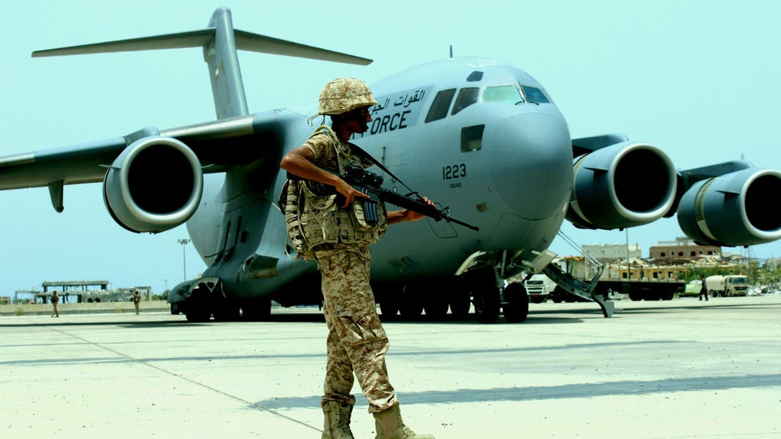 A soldier from the United Arab Emirates stands guard next to a UAE military plane at the airport of Yemen's southern port city of Aden August 8, 2015. (Reuters)
