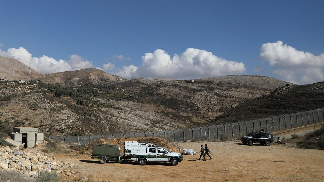 Israeli forces are seen at a border fence between the Israeli-occupied side of the Golan Heights and Syria, November 4, 2017. (Reuters)
