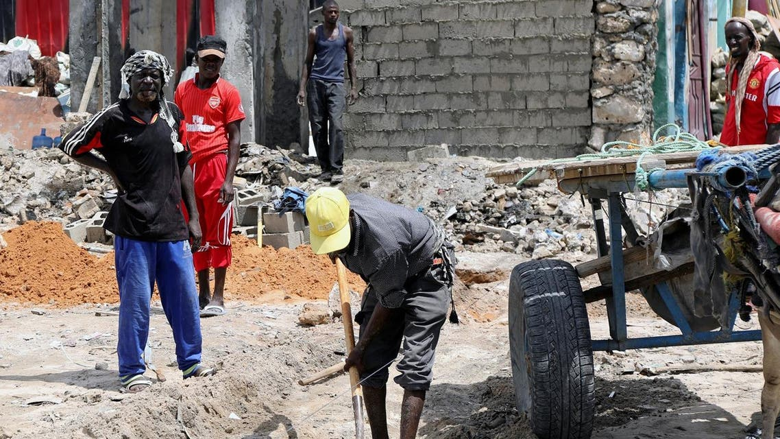 Construction workers repair buildings at the site of the October 14 twin bombings, in Mogadishu, Somalia, on October 25, 2017. (Reuters)
