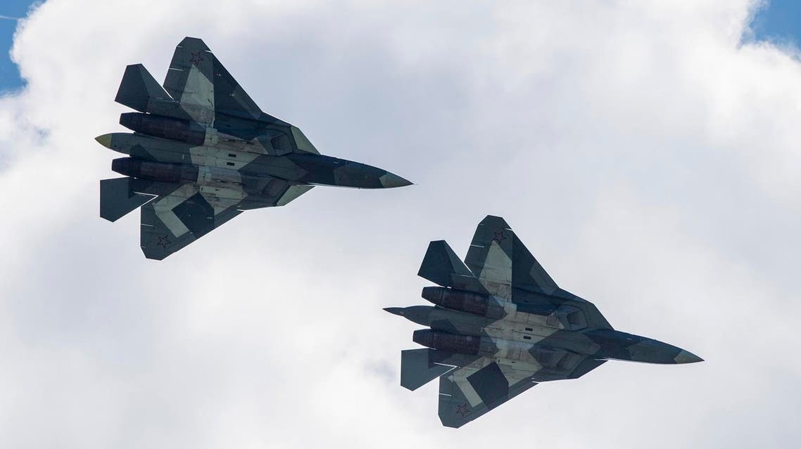 A pair of Russian SU34 military jets take part in an exhibition flight on July 18, 2017 at the annual air show MAKS 2017 in Zhukovsky, some 40 km outside Moscow. AFP