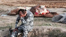 Two mass graves 'with bodies of 40 children' found in Yazidi district of Iraq