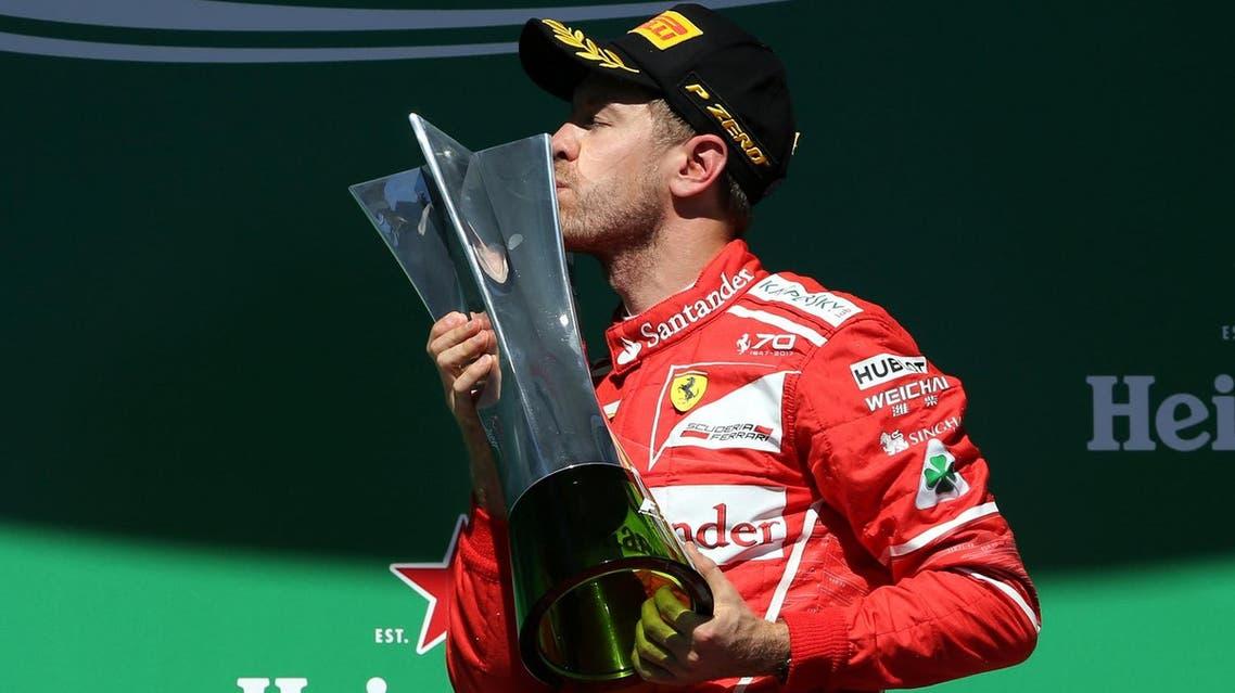 Ferrari's Sebastian Vettel celebrates winning the Sao Paulo, Brazil Grand Prix race on the podium (Reuters)