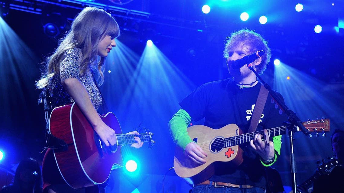 NEW YORK, NY - DECEMBER 07: Taylor Swift and Ed Sheeran perform onstage during Z100's Jingle Ball 2012, presented by Aeropostale, at Madison Square Garden on December 7, 2012 in New York City. Theo Wargo/Getty Images for Jingle Ball 2012/AFP
