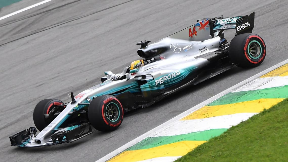 Mercedes' British driver Lewis Hamilton powers his car during the Brazilian Formula One Grand Prix Q1 qualifying session at the Interlagos circuit in Sao Paulo, Brazil, on November 11, 2017. Mercedes' Finnish driver Valtteri Bottas took pole for the Brazilian Grand Prix while teammate and newly-crowned world champion Lewis Hamilton crashed out and will start Sunday's race from the back of the grid. Ferrari pair Sebastian Vettel and Kimi Raikkonen were second and third fastest in qualifying. (AFP)
