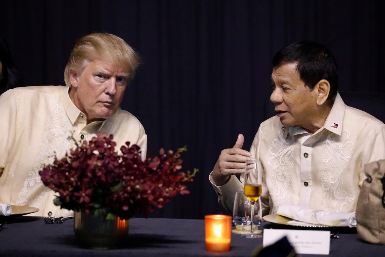 US President Donald Trump talks with Philippines President Rodrigo Duterte during the gala dinner marking ASEAN's 50th anniversary in Manila, Philippines November 12, 2017. (Reuters)