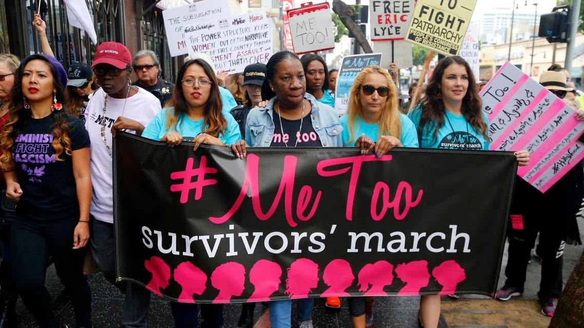 Participants march against sexual assault and harassment at the #MeToo March in the Hollywood section of Los Angeles on Sunday, Nov. 12, 2017. (AP