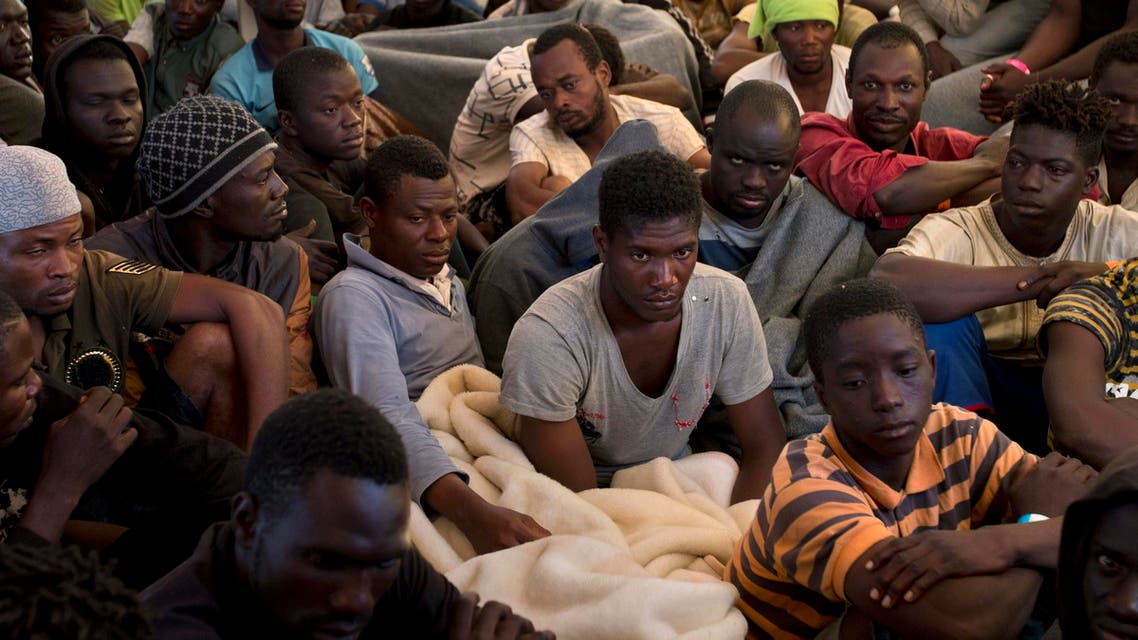 Migrants and refugees sit on the deck of the rescue vessel Golfo Azzurro after being rescued by Spanish NGO Proactiva Open Arms workers in the Mediterranean Sea Friday, June 16, 2017. (AP)