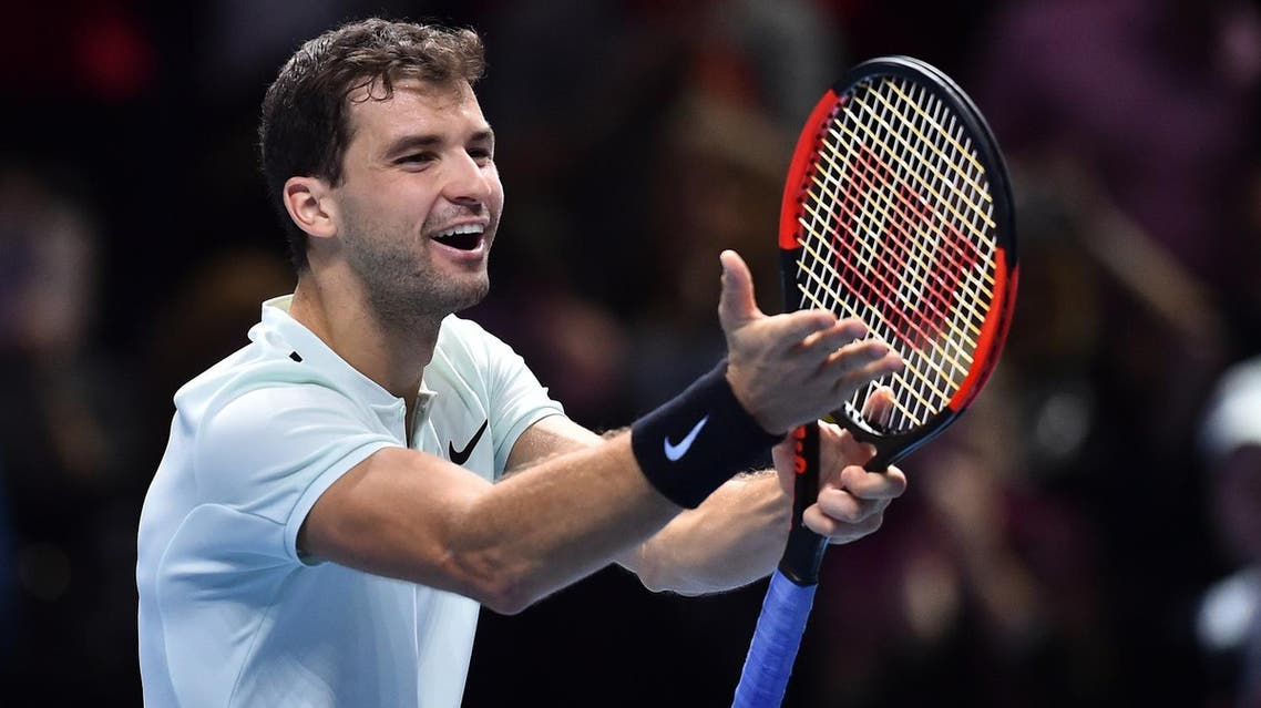 Bulgaria's Grigor Dimitrov celebrates his three set victory over Austria's Dominic Thiem during day two of the ATP World Tour Finals tennis tournament at the O2 Arena in London on November 13, 2017. (AFP)