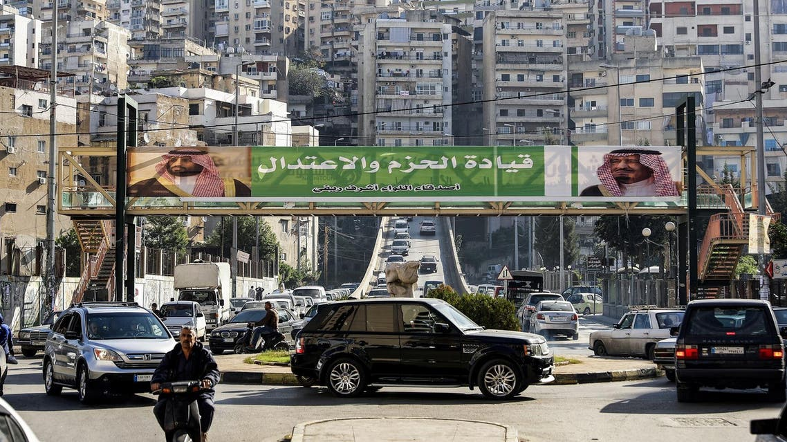 This November 10, 2017 photo shows a banner bearing the images of Saudi King Salman and Crown Prince Mohammed bin Salman on a pedestrian crossing in the Lebanese city of Tripoli. (AFP)