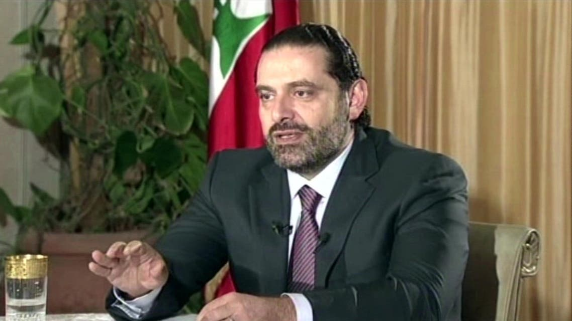 """Saad Hariri said he will return """"to complete the procedures for the resignation and the negotiation of a formula."""" (AP)"""