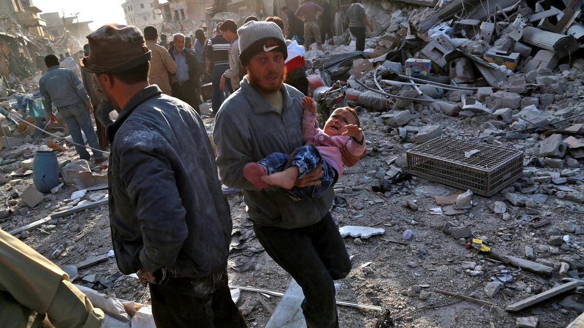 Civil defense workers rushed alongside civilians to evacuate the injured, with one man in a thick beanie hat carrying a wailing child in a pink sweater away from the scene. (AFP)