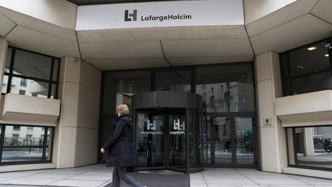 A picture taken on March 9, 2017, in Paris, shows the French headquarters of LafargeHolcim, a group created in 2015 by the merger of French cement manufacturer Lafarge and its Swiss counterpart Holcim. French-Swiss group LafargeHolcim is ready to sell its cement to build US President Donald Trump's controversial border wall, the company's CEO said in an interview. The wall Trump promised to erect along the US-Mexico border, valued at tens of billions of dollars, is at the center of a diplomatic crisis between Mexico City and Washington and is provoking criticism around the world.  Thomas SAMSON / AFP