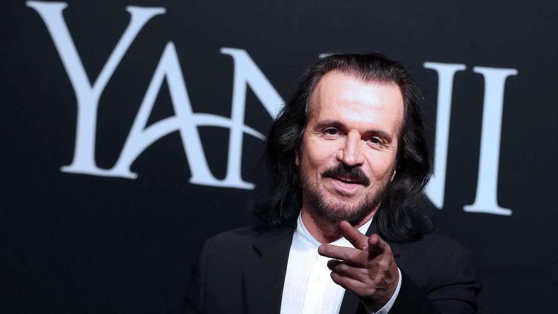 Greek musician Yanni poses for a photo before a press conference at Sheikh Jaber Al-Ahmad Cultural Center in Kuwait City on April 19, 2017. Yanni is set to perform two shows this weekend for the first time in the Gulf state as part of his international tour. Yasser Al-Zayyat / AFP