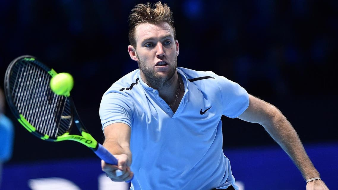 USA's Jack Sock returns against Croatia's Marin Cilic during their men's singles round-robin match on day three of the ATP World Tour Finals tennis tournament at the O2 Arena in London on November 14, 2017.  Glyn KIRK / AFP