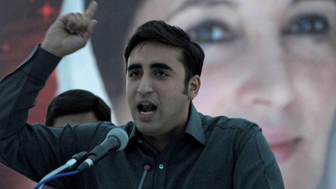 Bilawal Bhutto Zardari addresses supporters in front of a poster of slain prime minister Benazir Bhutto at a rally in Karachi on November 30, 2013. (AFP)