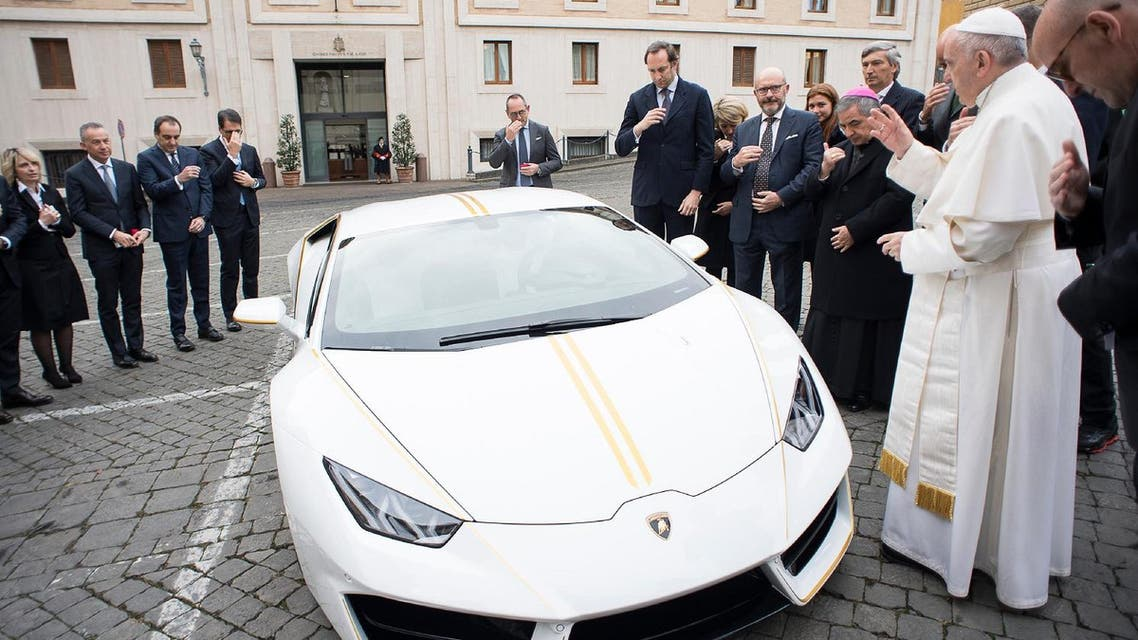 Pope Francis blesses a Lamborghini donated to him by the luxury sports car maker, at the Vatican, Wednesday, Nov. 15, 2017. (AP)