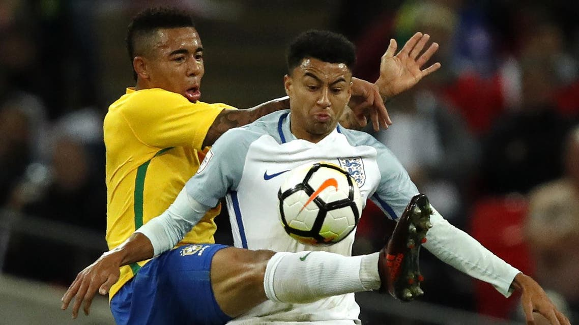 Brazil's striker Gabriel Jesus (L) vies with England's midfielder Jesse Lingard during the international friendly football match between England and Brazil at Wembley Stadium in London on November 14, 2017.  Adrian DENNIS / AFP