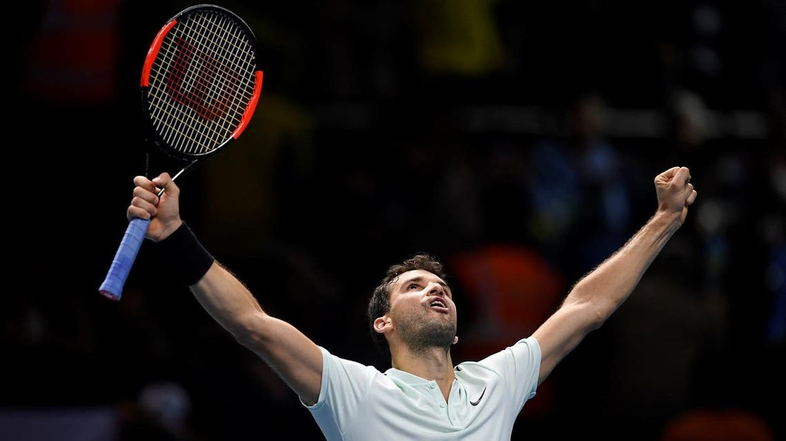 Bulgaria's Grigor Dimitrov celebrates winning his group stage match against Belgium's David Goffin. (Reuters)