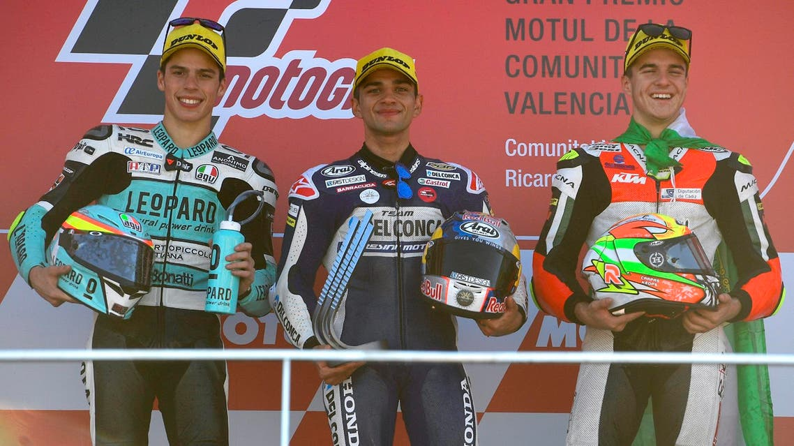 Jorge Martin (C) celebrates next to Joan Mir (L, second) and Marcos Ramirez (R, third) after winning the Moto3 race of the Valencia Grand Prix on November 12, 2017. (AFP)