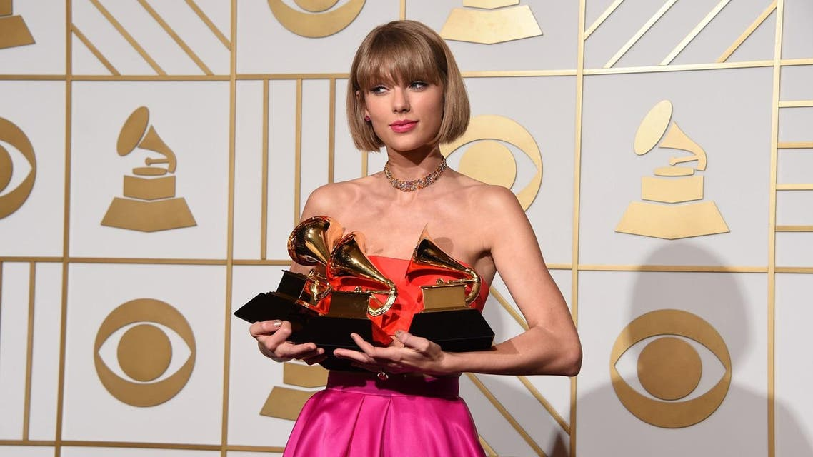 "(FILES) This file photo taken on February 15, 2016 shows singer Taylor Swift in the press room at the the 58th Grammy Awards at the Staples Center in Los Angeles, California. In her rise to pop superstardom, Swift was once earnest and anodyne, her life's disappointments more a chance for songs of perky commiseration than of rage. The world has changed, or maybe the 27-year-old has grown up. On ""Reputation,"" her sixth studio album, Swift is in a fighting spirit -- and the story is all about her. (AFP)"