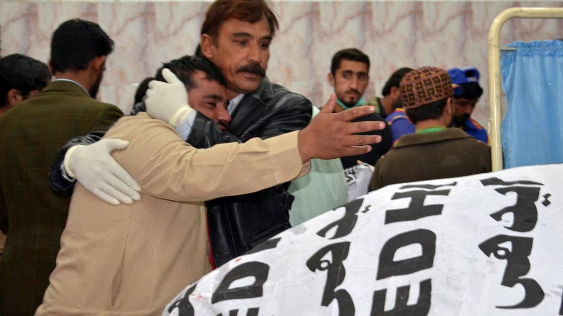 A paramedic staff comforts a relative after a police officer and three of his family members were shot dead in Quetta, Pakistan, on November 15, 2017. (Reuters)