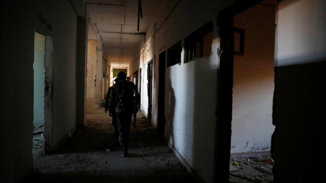 Fighters of Syrian Democratic Forces inspect the bunker of the Islamic State militants under the stadium in Raqqa, Syria October 18, 2017. Picture taken October 18, 2017. REUTERS/Erik De Castro