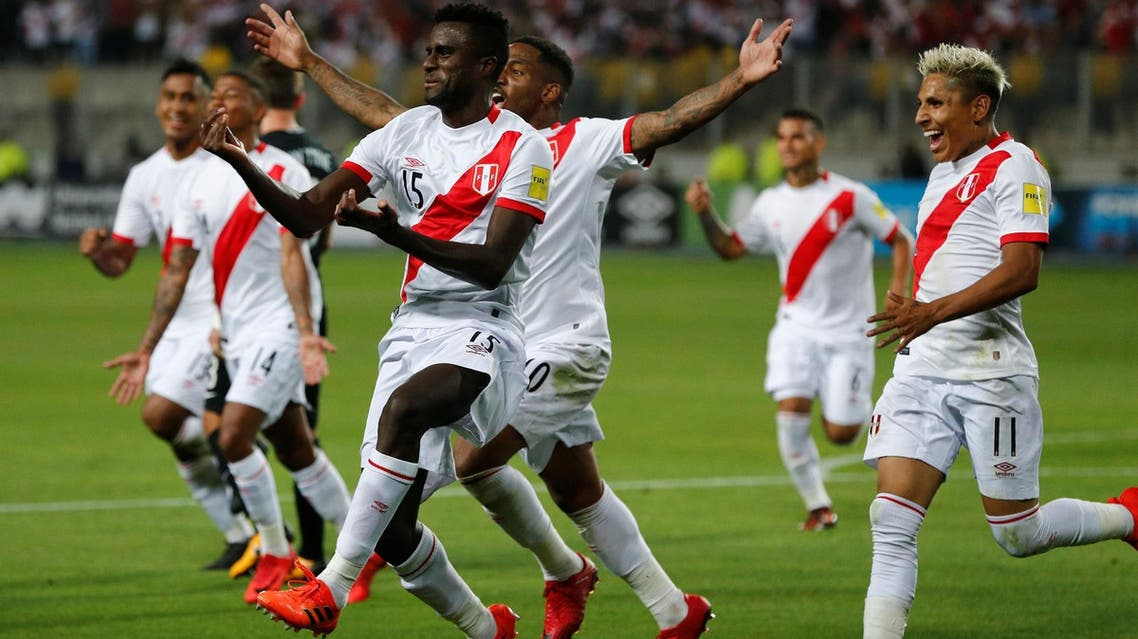 Peru's Christian Ramos (15) celebrates near teammates after scoring. (Reuters)