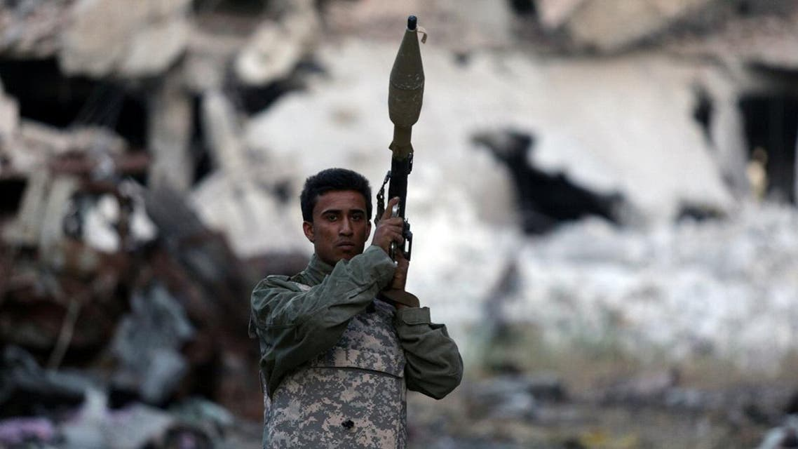 A member of the Libyan National Army holds a weapon during clashes with extremist militants in Khreibish district in Benghazi. (Reuters)