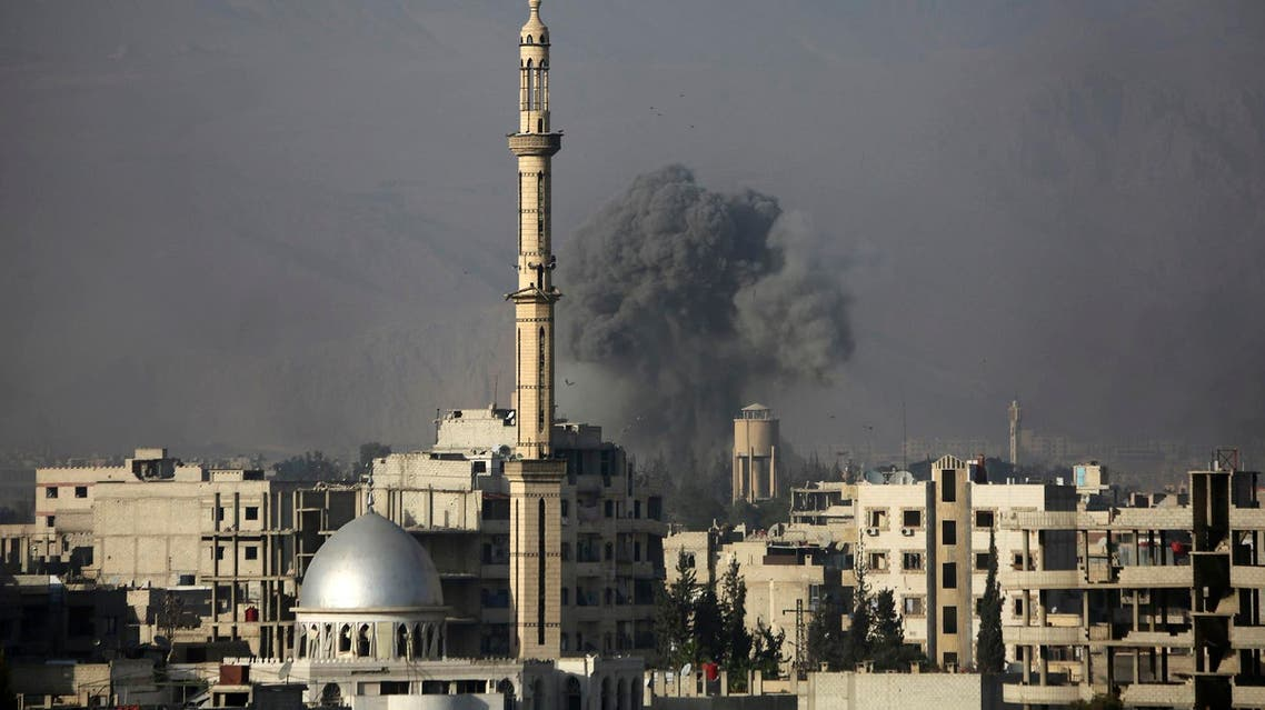 Smoke rises following an air strike on the rebel-held besieged town of Harasta, on the outskirts of Damascus, on November 15, 2017. (AFP)