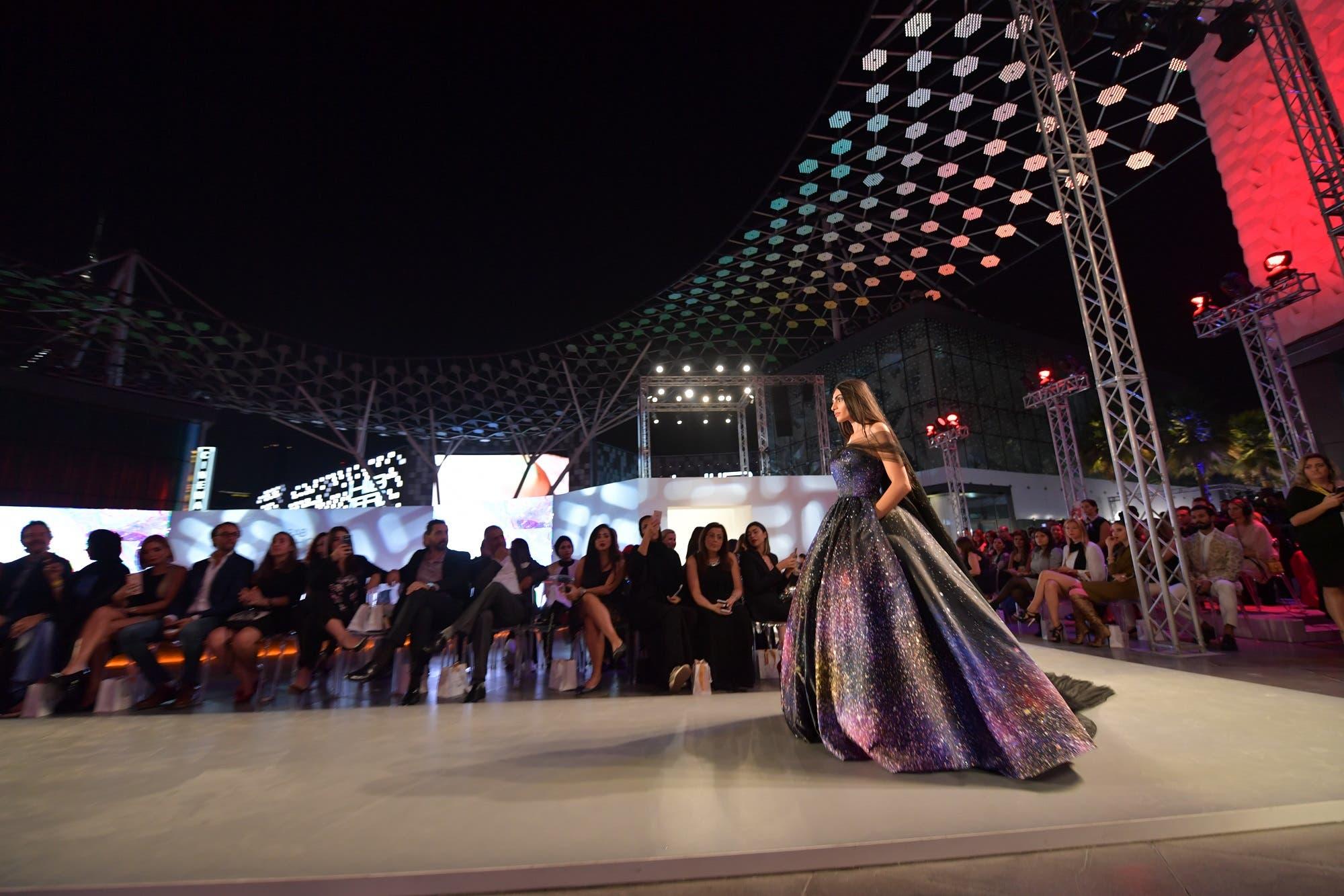 A model presents on the catwalk a creation of Aiisha Ramadan during the Arab Fashion Week in Dubai on November 15, 2017. (AFP)
