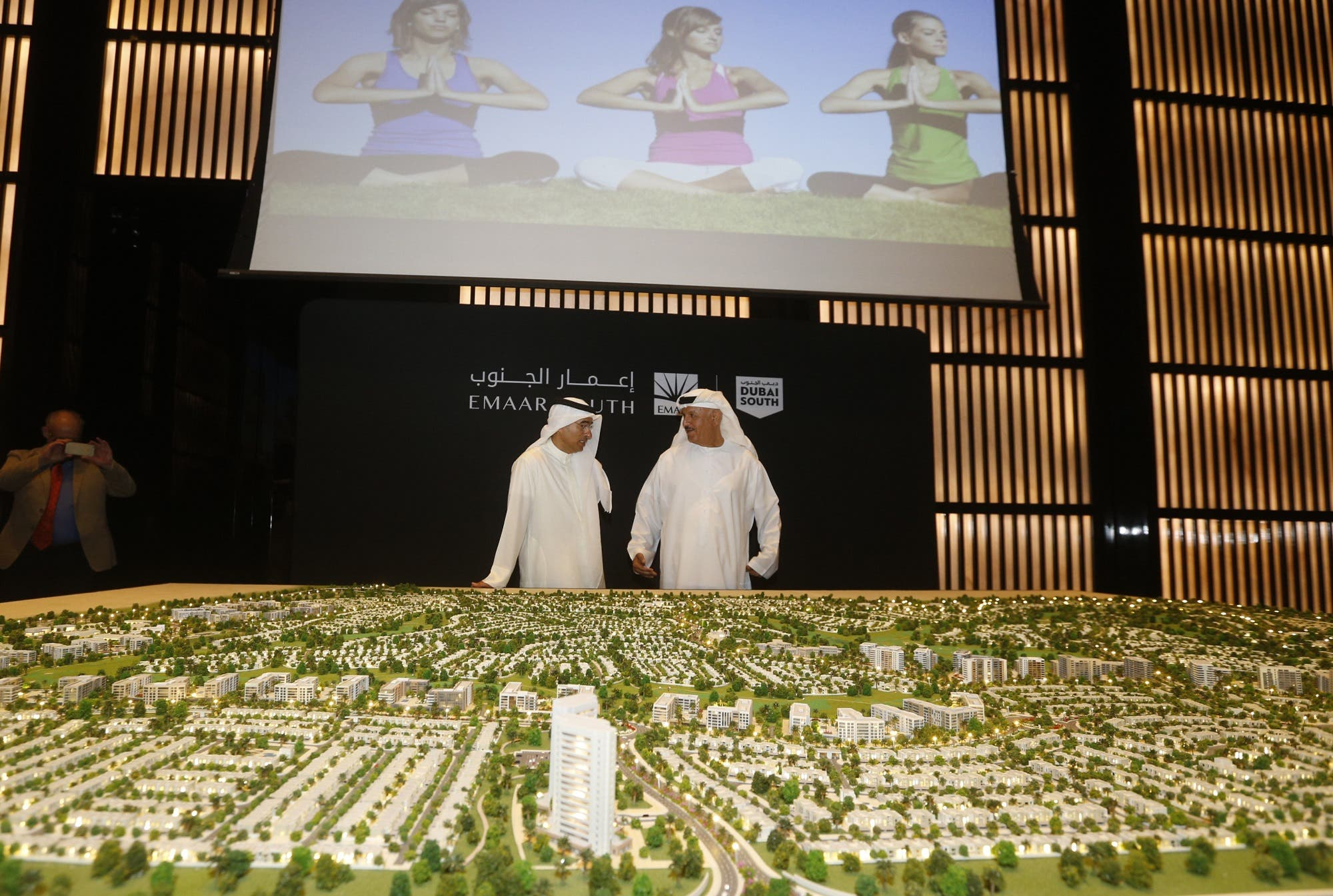 "Now-former Chairman of Dubai Emaar Properties Mohamed Alabbar (L) during the unveiling of the plans for the construction of the new ""Emaar South"" development in Dubai on September 5, 2016. (AFP)"