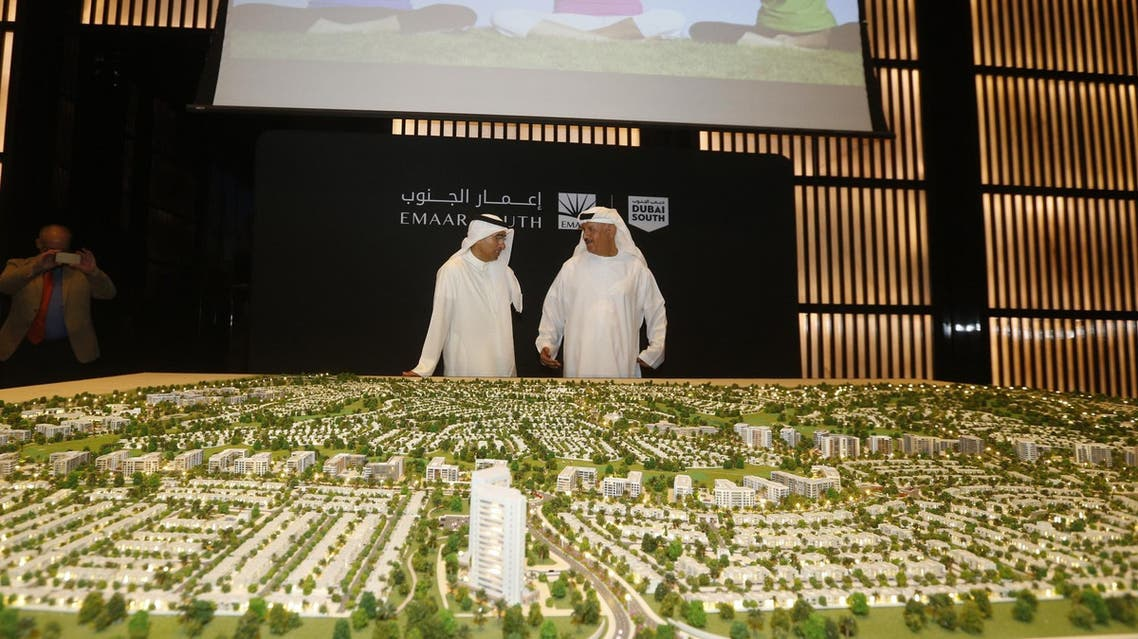 "Chairman of Dubai Emaar Properties Mohamed Alabbar (L) during the unveiling of the plans for the construction of the new ""Emaar South"" development in Dubai on September 5, 2016. (AFP)"