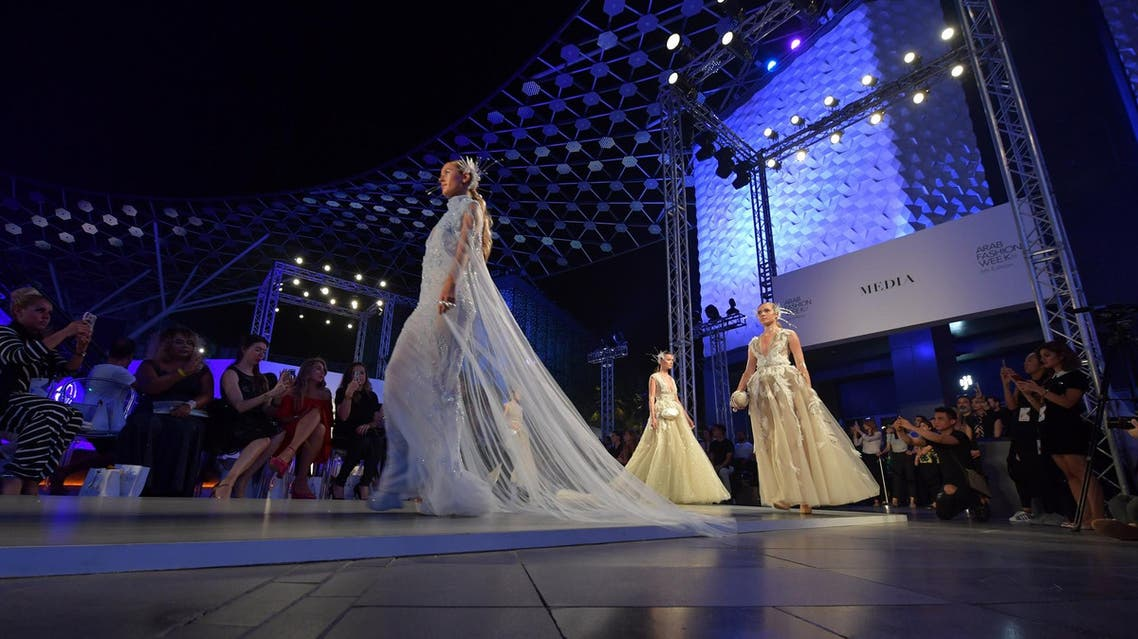 Models present creations by Amato during the Arab Fashion Week in Dubai on November 15, 2017. (AFP)