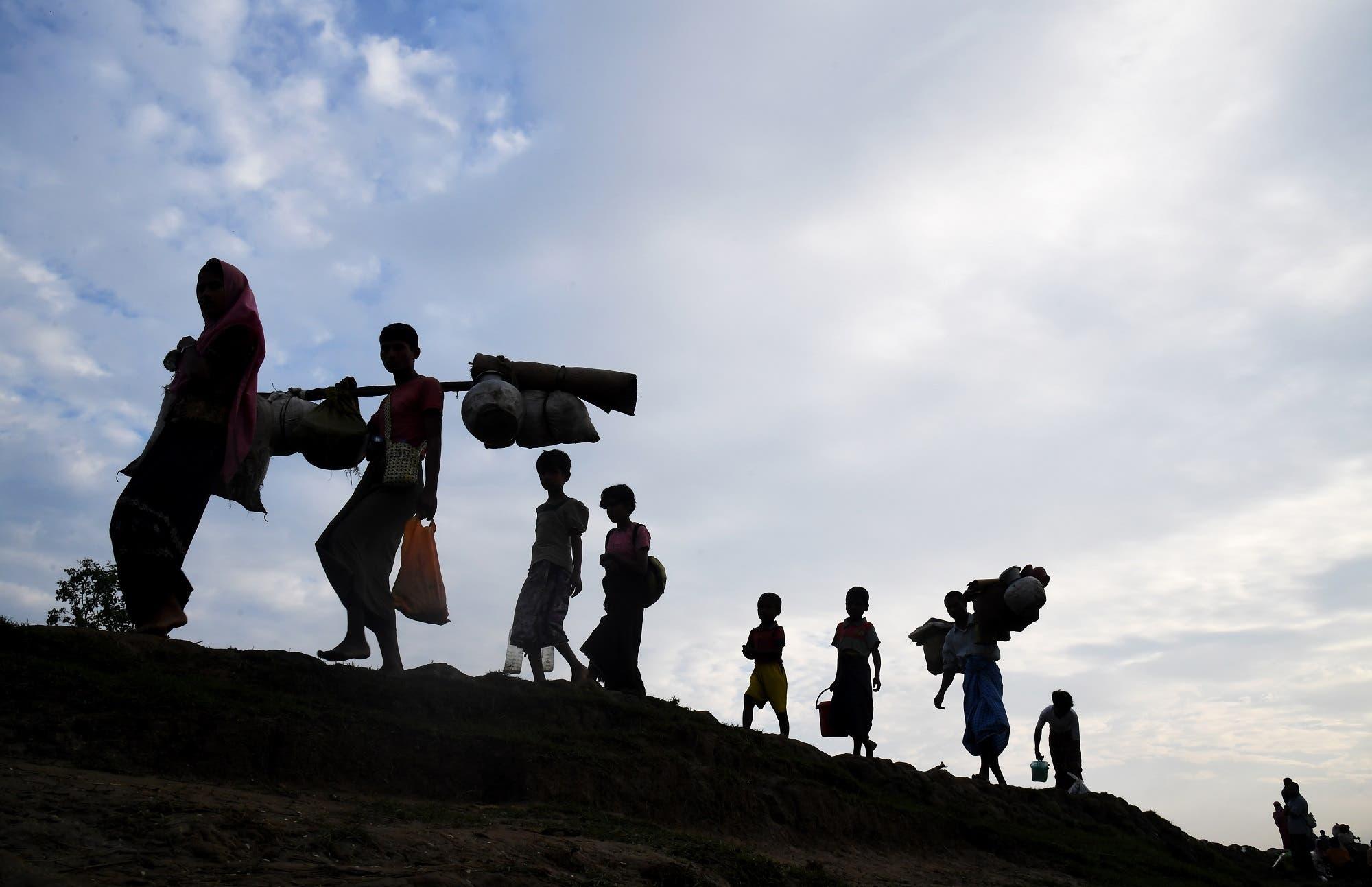 Rohingya refugees walk into Palongkhali in Bangladesh's Ukhia district on November 2, 2017. (AFP)