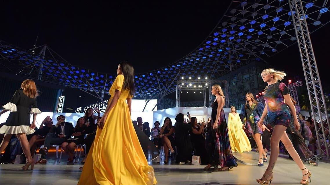 Models present on the catwalk creations of Aiisha Ramadan during the Arab Fashion Week in the United Arab Emirate of Dubai on November 15, 2017. (AFP)