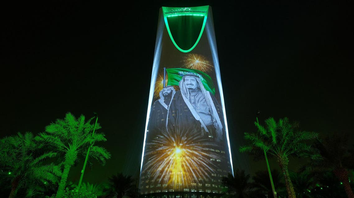 In this Sept. 24, 2017 photo, the image of King Salman and Crown Prince Mohammed bin Salman are projected on the Kingdom Tower during National Day ceremonies in Riyadh. (AP)