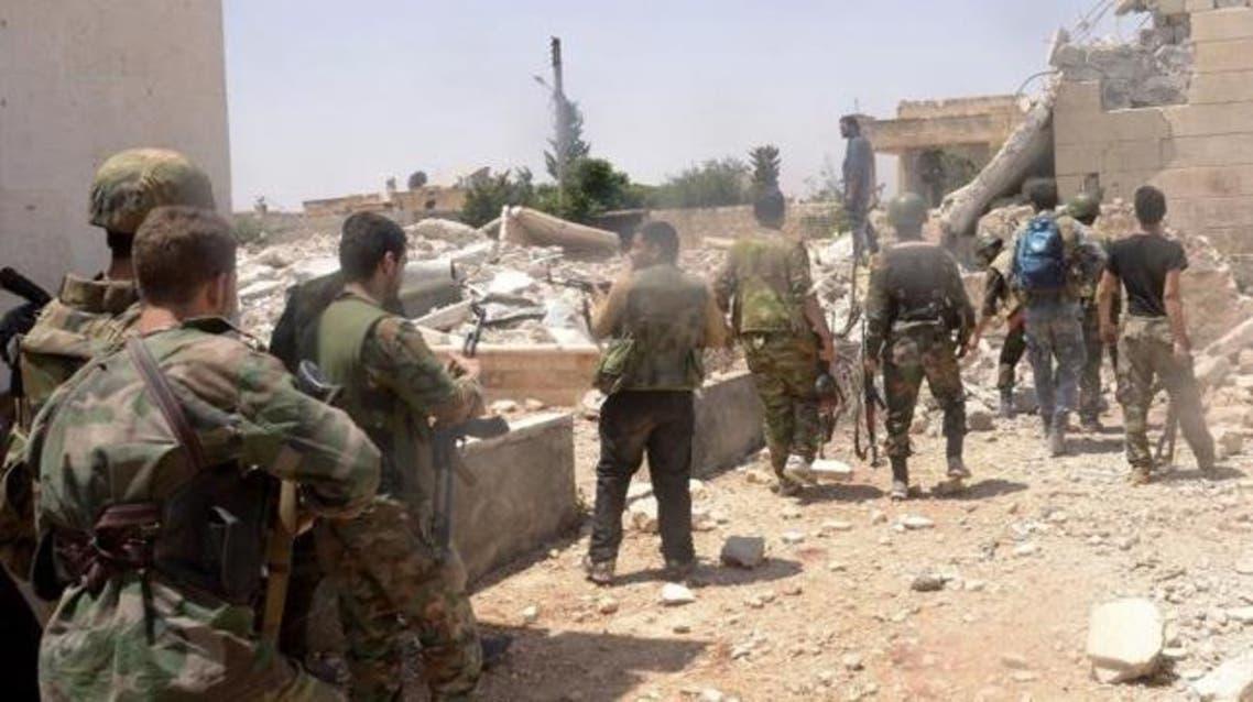 قوات من جيش النظام السوري خلال معارك مدينة البوكمال