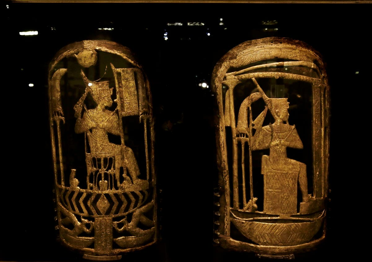 Ancient Egyptian shields made of wood covered with gesso and gold leaf displayed in a glass case during the exhibition of Tutankhamun's unseen treasures marking the 115th anniversary of the Egyptian museum in Cairo, Egypt, Wednesday, Nov. 15, 2017. Egypt displayed previously unseen treasures from King Tutankhamun's famed tomb. (AP)